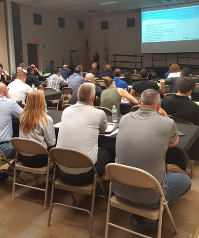 Cali Estes from The Addictions Academy teaching a free course to first responders and police officers.